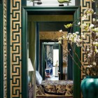 greek key motif - gold Greek fret border around a green-painted doorway - Veranda via Atticmag