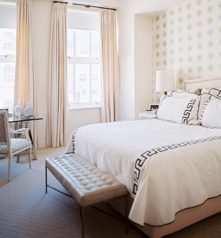 black Greek key motif on linens in a bedroom by Sara Gilbane - Designersraum via Atticmag