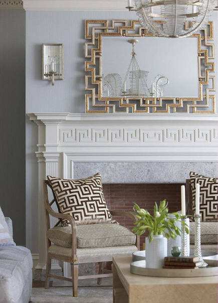 greek key motif - living room with Greek fret motifs on the mantel, pillows and mirror -- Sweethome via Atticmag