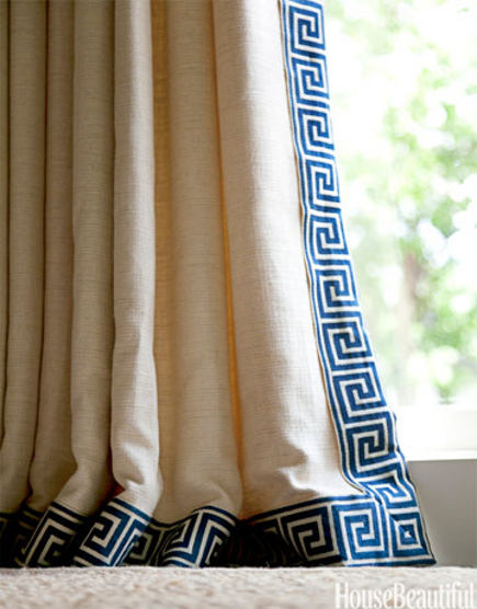 greek key motif - blue Greek key border on draperies - House Beautiful via Atticmag