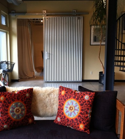 corrugated tin panels - interior barn door by Zesty Nest via Atticmag