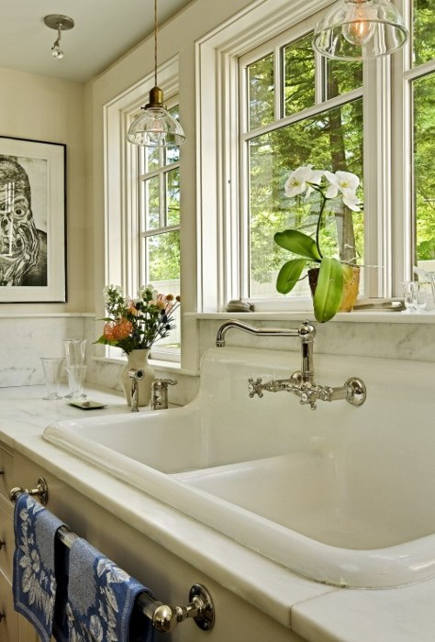 double bowl kitchen sink - cast iron salvage sink with integral backsplash - Smith and Vansant via Atticmag