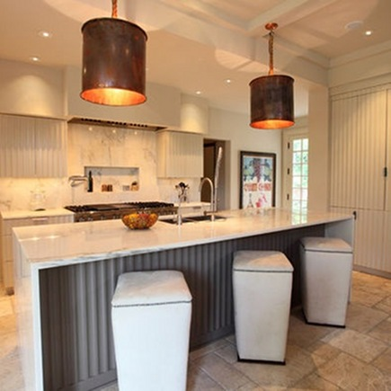 custom fluted cabinetry in a kitchen by Frost and Keading via Atticmag