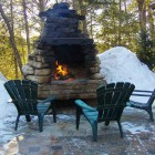 outdoor fireplaces - stone fireplace in Canada - flickr via Atticmag