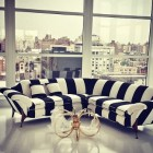 black and white striped decor - Black and white stripe sectional sofa in the Alice + Olivia showroom – sukio.com via Atticmag
