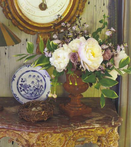 white roses with green foliage by Nicolette Owen - Veranda via Atticmag