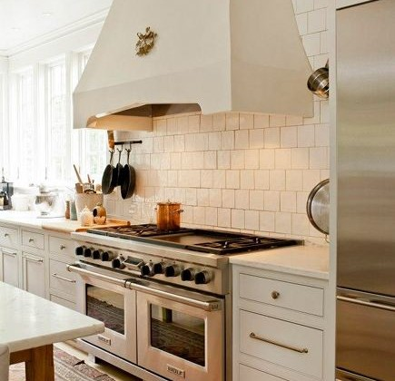 kitchen hood style- custom plaster range hood by Cantley and Company via Atticmag