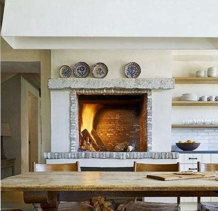 kitchen luxuries - wood burning fireplace in a rustic kitchen - David Michael Miller via Atticmag