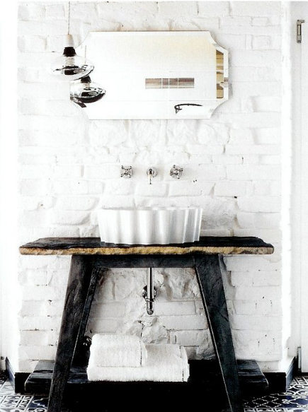bathroom table vanities - Paola Navoni pieform sink on a console in a house in Spello - dwell via atticmag