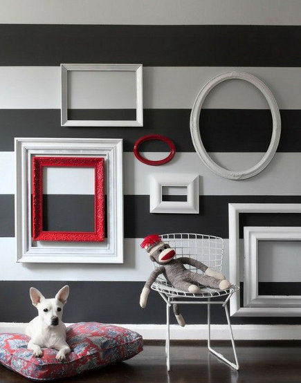 striped walls - horizontal stripes with picture frame decoration - hgtv via Atticmag