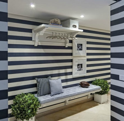 horizontal striped walls with coat rack and pictures - decorole via Atticmag