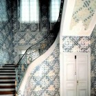 sculptural interior staircases - antique Dutch Delft Tiles curved staircase - via Atticmag
