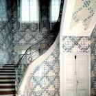 sculptural interior staircases - antique Dutch Delft Tiles curved staircase - via Atticmag