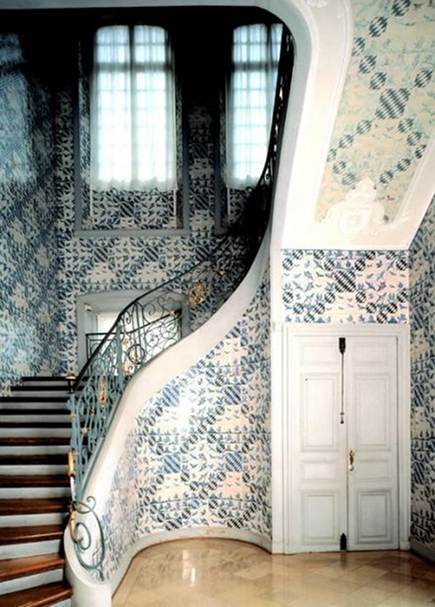 sculptural interior staircases - antique Dutch Delft Tiles curved staircase - vvia Atticmag