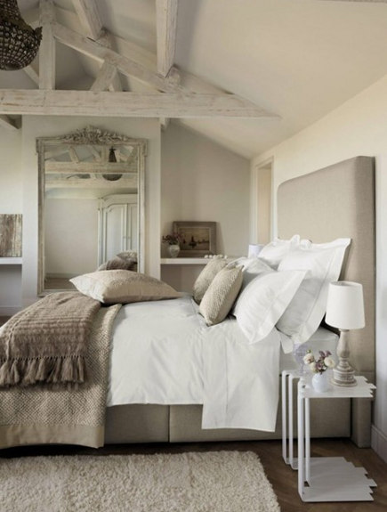 neutral bedroom decor with toast-colored throw - The Paper Mulberry via Atticmag