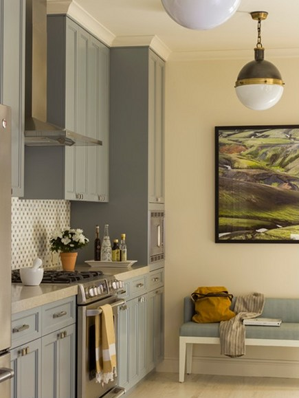 light blue kitchen cabinets in a blue gray transitional kitchen by Angela Free Design via Atticmag