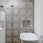 cement tile pattern - large-scale Gray Royal cement tiles used on a bathroom wall and floor - thedesignfiles.net via Atticmag