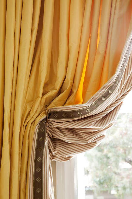 drapery details - double-sided drapery by Palmer Weiss with tape on the reverse - trad home via atticmag