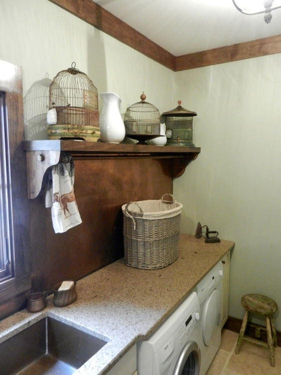 copper backsplash Allison's laundry room - via Atticmag