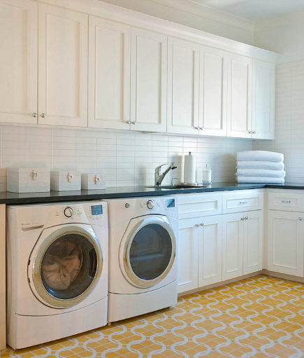 laundry room built ins - laundry room with yellow and white cement tile floor - homebunch via atticmag
