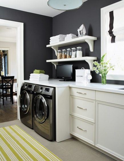 laundry room built ins - washer and dryer built into a corner of the kitchen - decorpad via atticmag