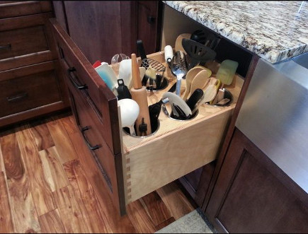 kitchen cabinet pull out ideas - base cabinet utensil well pull out - hei design via atticmag