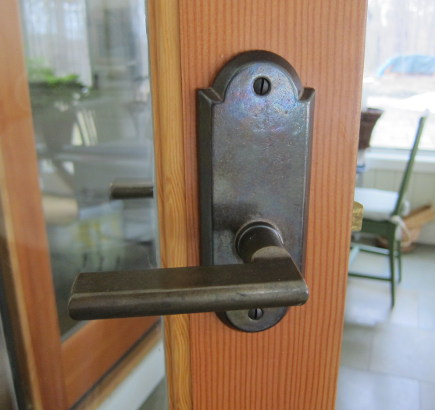 spring cleaning tips - wiping door handles with alcohol removes germs - atticmag