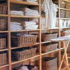 linen closet organization - open shelves and basket storage - pinterest via atticmag