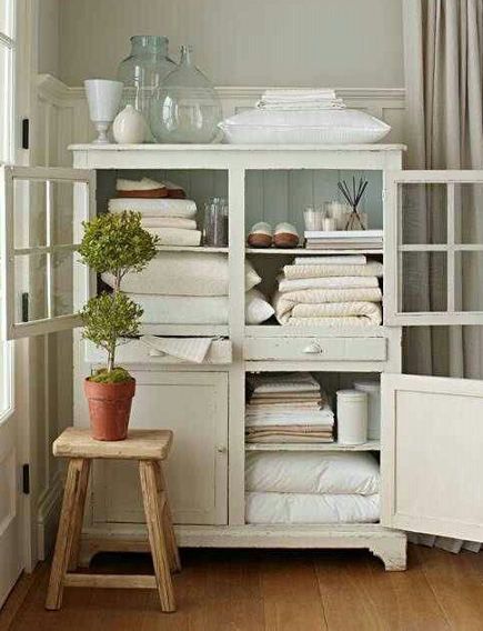 linen closet organization - white painted vintage linen cupboard - tempurpedic via atticmag