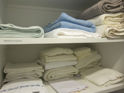 linen closet organization - custom deep shelves in a linen closet - atticmag