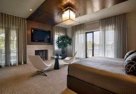 flat screen tv hung over wood paneling above a fireplace - b&g design via atticmag