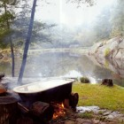 outdoor bathtub in the Connecticut woods - World of Interiors via Atticmag