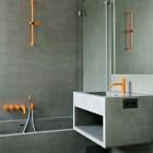 Vola orange bathroom faucets in a modern concrete bath - kaleidoscopeblog via atticmag