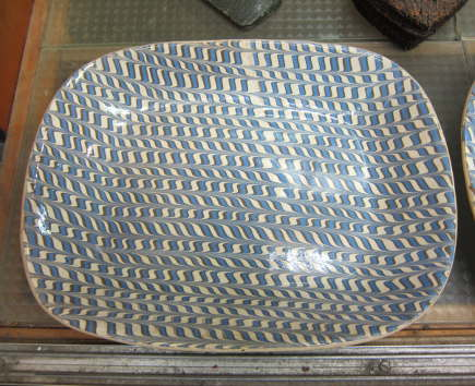 antique creamware platter with blue combed decoration at a country auction - Atticmag