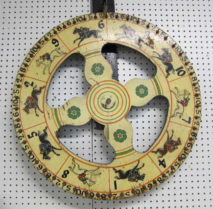 vintage gaming wheel with horse decals at a country auction - Atticmag