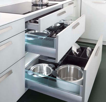 kitchen cabinet lighting - Illuminated pot and pan drawers in Leicht kitchen cabinets - leicht contracts via Atticmag