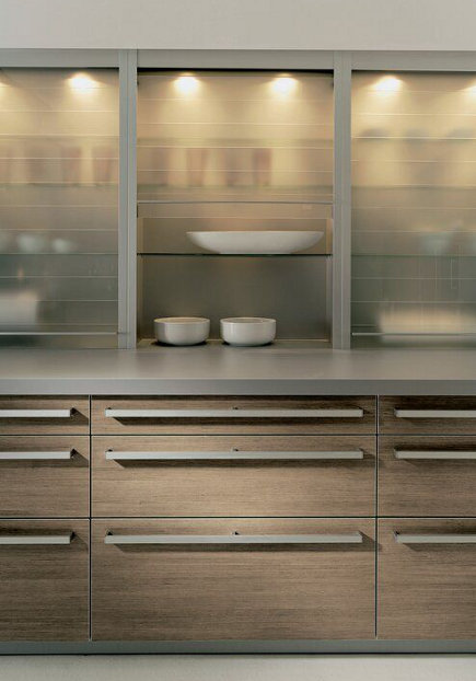 kitchen cabinet lighting - Alno Light Wood kitchen cabinets with lighted Hafele glass tambor door uppers - Alno via Atticmag