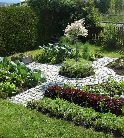 kitchen gardens - kitchen garden with pavers in the shape of a Celtic cross - Pinterest via Atticmag