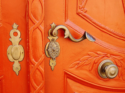 orange home decor on a front door- thefrenchtangerine via atticmag