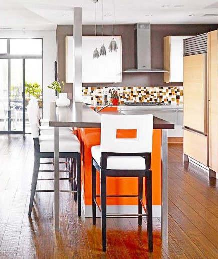 orange home decor on a kitchen island in mid-century modern style kitchen – bhg via atticmag