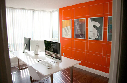 orange home decor accent wall with white grid in home office – lifehacker via atticmag