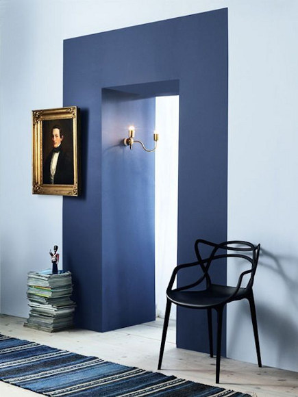 paint is used to create a color block door frame on an opening between rooms - Skonahem via Atticmag