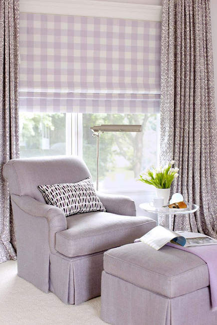 layered window treatments in a bedroom include a labender check Roman shade under lavender print drapery panels - Amanda Nisbet via Atticmag