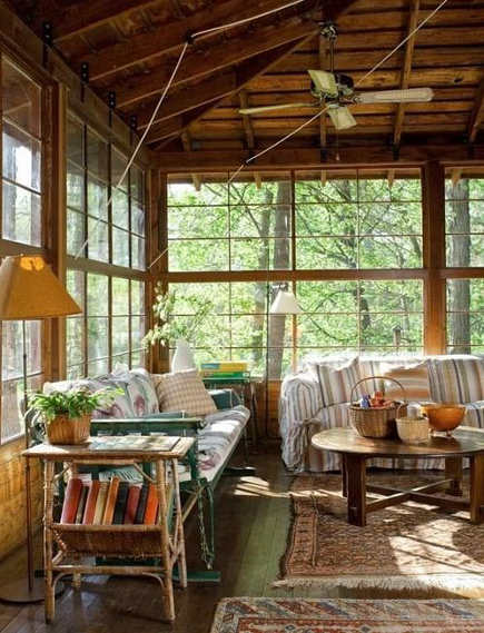 vintage lake house porch with antique windows - oldhouseonline via atticmag