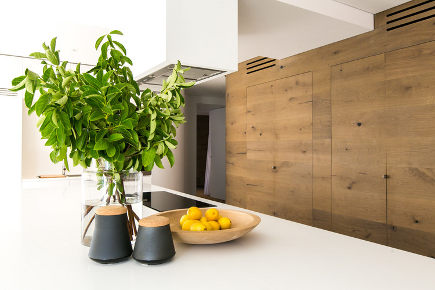 curved oak kitchen - Mafi curved oak plank kitchen with curved walls – CM Studio via Atticmag