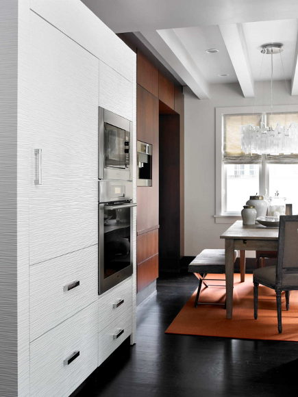 paneled refrigerator and Miele ovens in modern kitchen with Andy Blick discus dimensional tile - HammerSmith via Atticmag