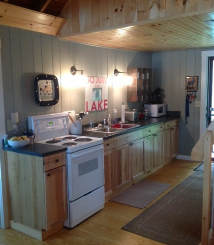 basic kitchen in a lake camp cottage in Maine - Atticmag