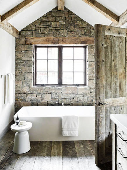 stone wall and timber bath with contemporary freestanding tub – On Site Management via Atticmag
