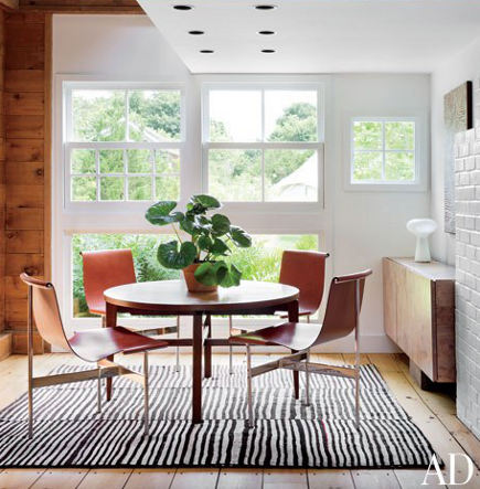 zebra print carpets mid-century kilim in a dining space – AD via Atticmag