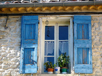weather worn sevres blue shutters on a stone house - weloveprovence via Atticmag